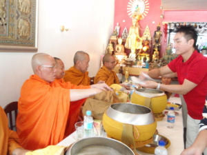 Give alms to a Buddhist monk 15