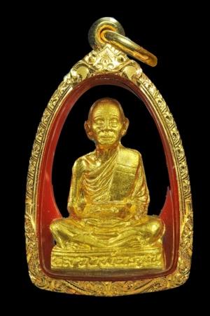 รูปเหมือนปั้ม รุ่นแรก หลวงพ่อคูณ วัดบ้านไร่ รุ่นคูณพระเทพประทานพร พ.ศ. 2536 เนื้อทองคำ หมายเลข 315